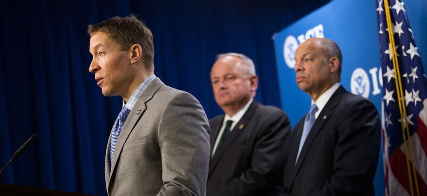 Daniel Ragsdale, left, speaks at a 2014 news conference at the ICE headquarters.
