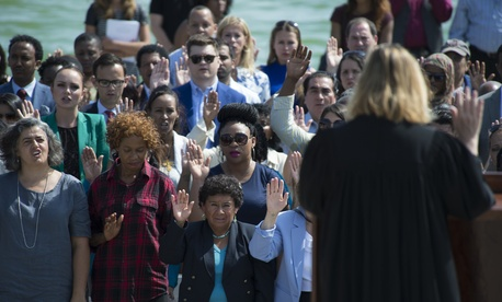 Beryl A. Howell, chief judge for United States District Court for the District of Columbia, swore in several dozen new U.S. citizens from the steps of the Lincoln Memorial on Sept. 16, 2016.