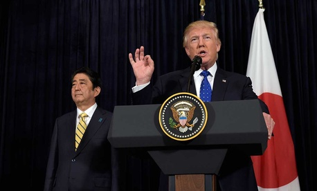 President Donald Trump speaks as Japanese Prime Minister Shinzo Abe listens on Saturday at Mar-a-Lago.