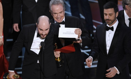 "Jordan Horowitz, producer of ""La La Land,"" shows the envelope revealing ""Moonlight"" as the true winner of best picture at the Oscars on Sunday, Feb. 26."