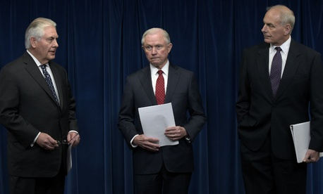 From left, Secretary of State Rex Tillerson, Attorney General Jeff Sessions and Homeland Security Secretary John Kelly hold a press conference where they vow to collaborate on the new executive order.