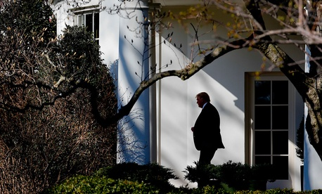 President Donald Trump walks near the White House in February.