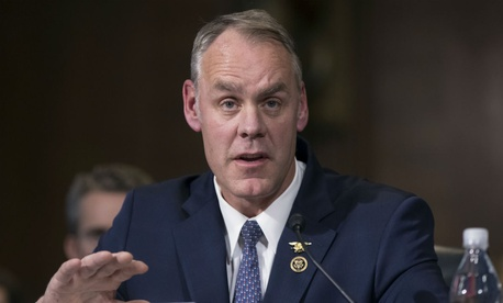 Ryan Zinke testifies at a confirmation hearing on Capitol Hill.