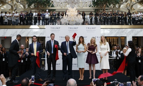 Donald Trump and family members attend the grand opening of Trump International Hotel in October.