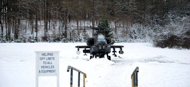A Boeing AH 64D Apache Longbow attack helicopter crew initiates its first itinerary during the operation Dire Wolf at Grafenwoehr Training Area in Germany in January.