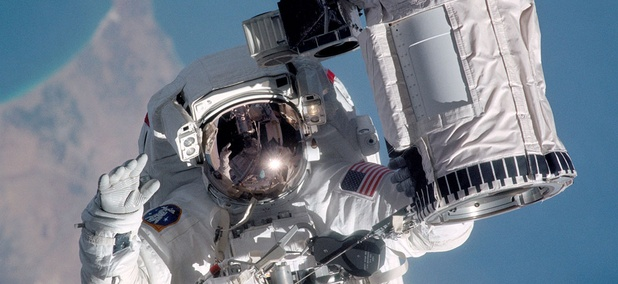 Michael Gernhardt performs a Station spacewalk around the International Space Station in 1995.