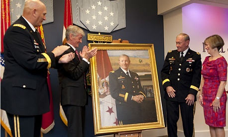 In 2012, then Army Chief of Staff Gen. Raymond Odierno; Secretary of the Army John McHugh; Gen. Martin Dempsey, chairman of the Joint Chiefs of Staff, and his wife, Deanie, look at Dempsey's portrait during a ceremony at the Pentagon.