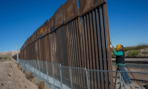 A worker welds a new fence between the Anapra neighborhood of Ciudad Juarez, Mexico, and Sunland Park, New Mexico, on March 30.