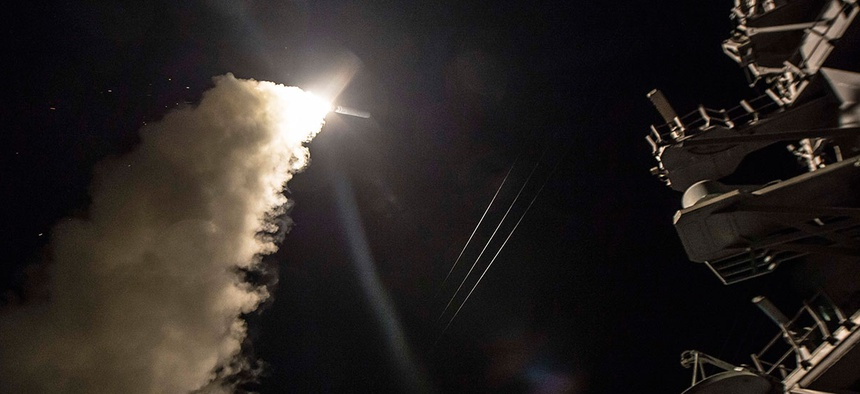USS Ross (DDG 71) fires a tomahawk land attack missile April 7.