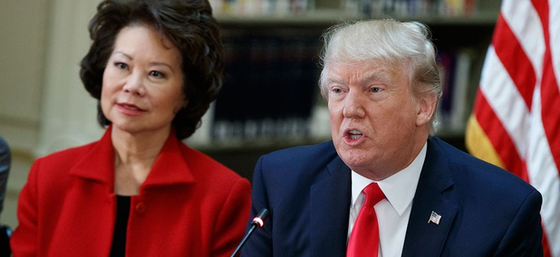 President Trump and Transportation Secretary Elaine Chao at a White House meeting with business leaders April 11.