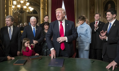 President Donald Trump is joined by the Congressional leadership and his family as he formally signs his cabinet nominations into law Jan. 20.