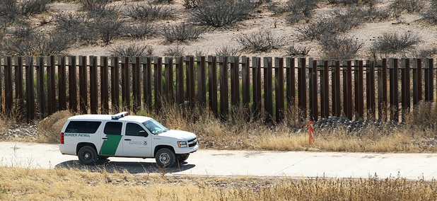 A CBP truck drives along the border fence in Arizona in 2011.