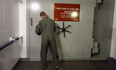 1st Lt. Phil Parentrau opening the blast door leading to the underground control room at an ICBM launch control facility near Minot, N.D. in 2014.