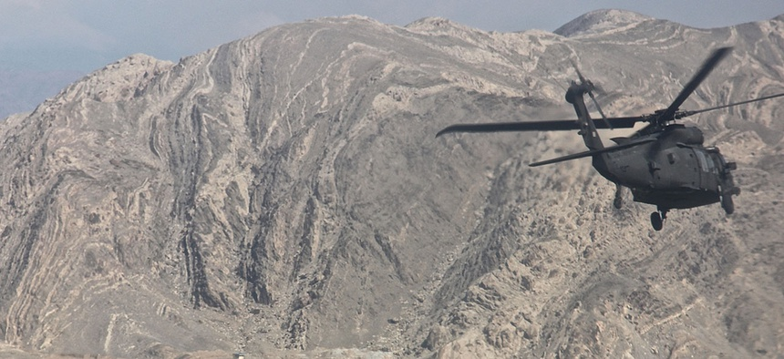 A UH-60 Black Hawk helicopter carrying leaders and advisers from Train, Advise, Assist Command - East, Resolute Support Mission, and Combined Security Transition Command-Afghanistan travels to the Nangarhar police Regional Logistics Center in 2015.