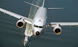 A P-8A Poseidon overflies the U.S. Navy's DDG 1000 destroyer in October 2016. The subhunting plane has been approved for export to New Zealand.