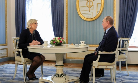 Vladimir Putin speaks to French far-right presidential candidate Marine Le Pen, in the Kremlin in Moscow in March.