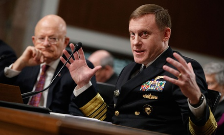 Director of National Intelligence James Clapper listens at left as National Security Agency and Cyber Command chief Adm. Michael Rogers testifies on Capitol Hill in Washington, Thursday, Jan. 5, 2017,