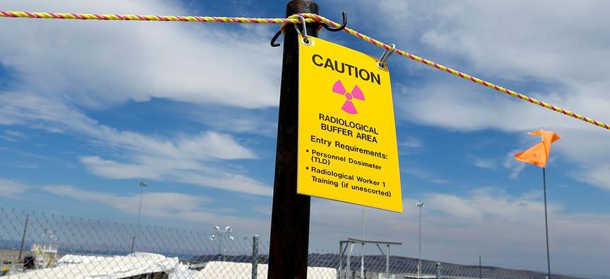"""Sign warning of radioactivity at the """"C"""" tank farm at the Hanford."""