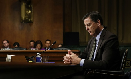 Then-FBI Director James Comey testifies on May 3, six days before President Trump fired him.