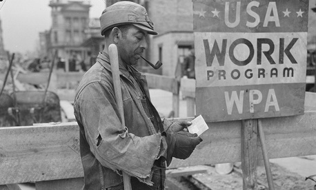 A Works Progress Administration worker receives a paycheck in