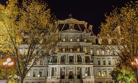 The Eisenhower Executive Office Building at night.
