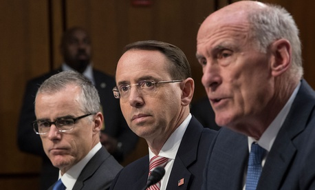 Acting FBI Director Andrew McCabe, Deputy Attorney General Rod Rosenstein, and Director of National Intelligence Dan Coats, testify before a Senate Intelligence Committee hearing about the Foreign Intelligence Surveillance Act on Wednesday.