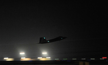 An F-22A Raptor launches from the U.S. Central Command area of responsibility for strike operations in Syria Sept. 23, 2014.