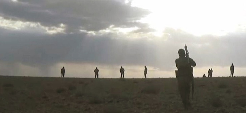Syrian government troops take up positions in southern Syria in May.