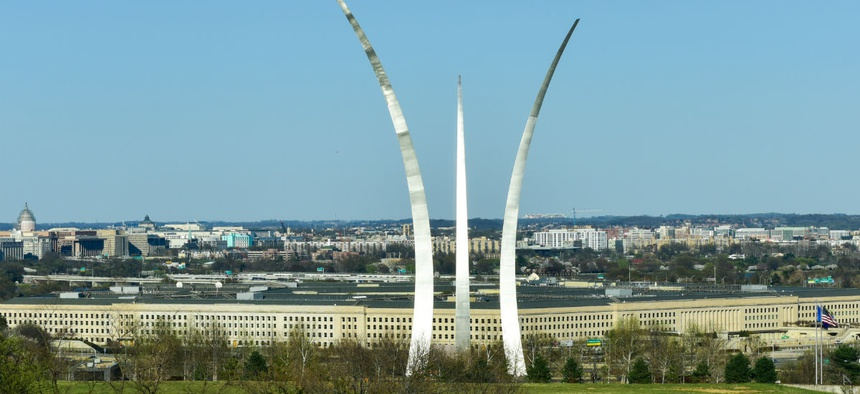 The Air Force Memorial against the backdrop of the Pentagon and the U.S. Capitol in the background.