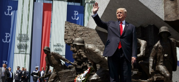 President Donald Trump waves as he arrives to deliver a speech at Krasinski Square at the Royal Castle on July 6.