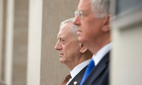 Defense Secretary Jim Mattis stands with the United Kingdom's Secretary of State for Defence Sir Michael Fallon before a meeting at the Pentagon.