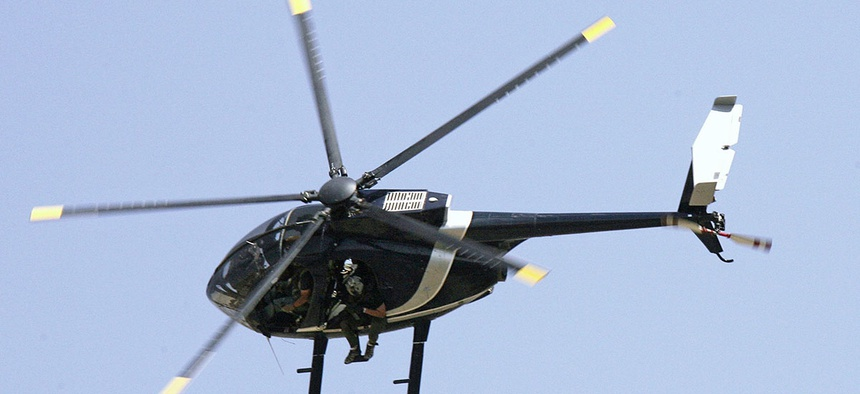 Blackwater security contractors are seen inside a helicopter above central Baghdad in 2007.