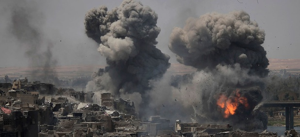 "Airstrikes target Islamic State positions on the edge of the Old City a day after Iraq's prime minister declared ""total victory"" in Mosul on Tuesday."