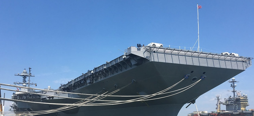 The aircraft carrier Pre-Commissioning Unit Gerald R. Ford (CVN 78) is shown docked at Pier 11 of Naval Station Norfolk in June.