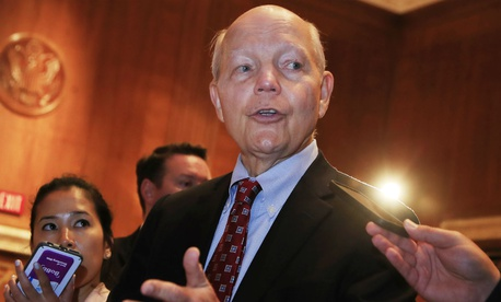 IRS chief John Koskinen speaks to reporters after testifying on his agency's budget.