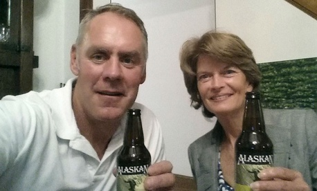 Interior Secretary Ryan Zinke and Sen. Lisa Murkowski, R-Alaska, have a beer in Washington. Zinke tweeted the photo to show the two were getting along, after reports that he threatened Murkowski over her health care vote.