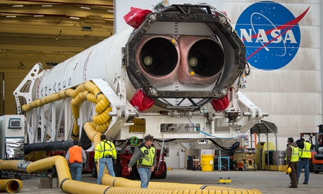 An Orbital Sciences Corporation Antares rocket is seen as it is rolled out to launch Pad-0A at NASA's Wallops Flight Facility in 2014