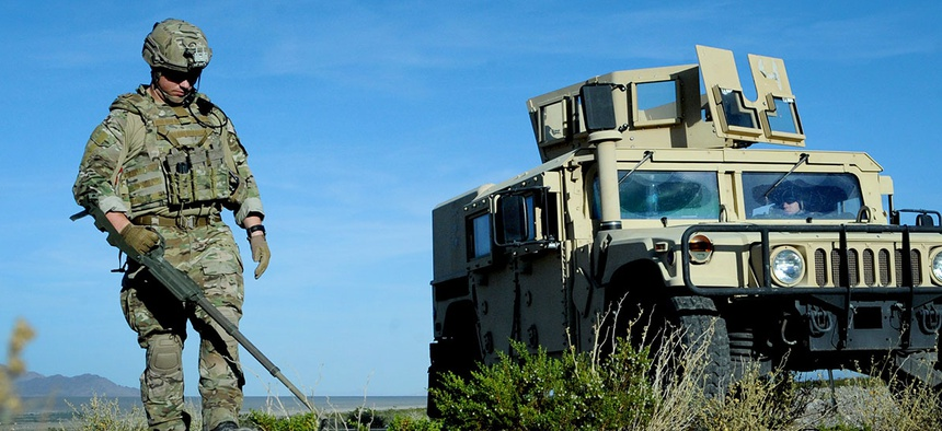 Tech Sgt. Nathaniel Jackson, 99th Civil Engineer Squadron explosive ordnance disposal technician, begins a roadside bomb clearing operation during a training event June 7, 2017 at the Nevada Test and Training Range.