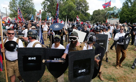 White nationalist demonstrators hold their ground as they clash with counter demonstrators in Lee Park in Charlottesville on Saturday.