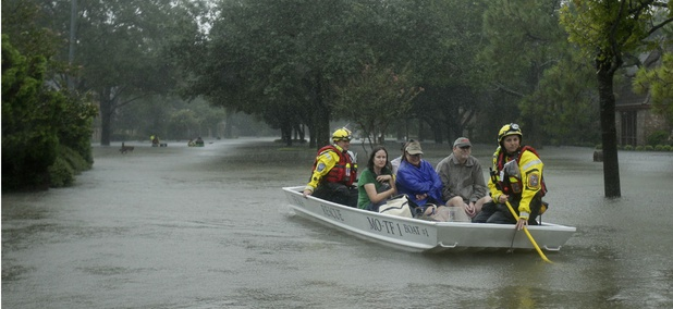A FEMA rescue team evacuates people from a neighborhood inundated by floodwaters from Tropical Storm Harvey on Monday, Aug. 28.
