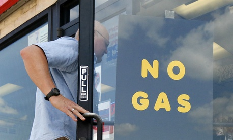 A customer walks into an Exxon filling station and convenience store on Aug. 31 in Bedford, Texas.