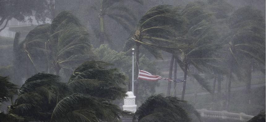An American flag is torn as Hurricane Irma passes through Naples, Fla., Sunday, Sept. 10.