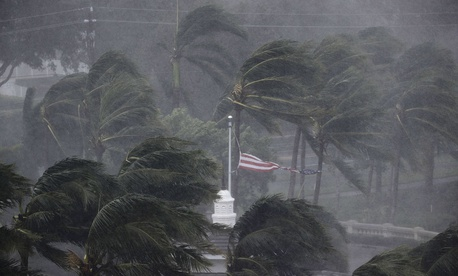 An American flag is torn as Hurricane Irma passes through Naples, Fla., Sunday, Sept. 10.