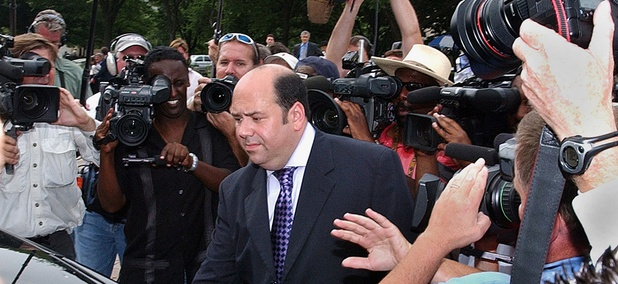 Mathew Cooper, center, leaves U. S. District Court in Washington Wednesday, July 6, 2005, after agreeing to cooperate with federal prosecutor's investigation into the leak of the identity of CIA operative Valerie Plame.