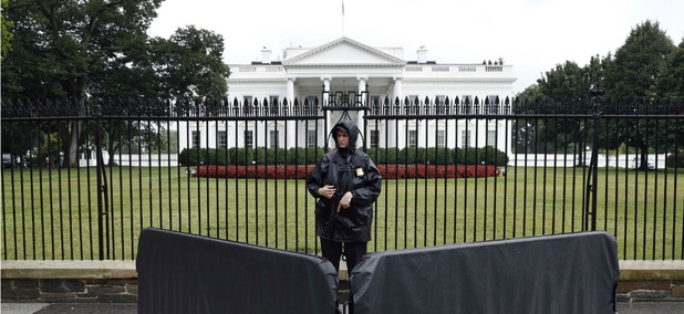 A Secret Service agent stands guard outside the White House.