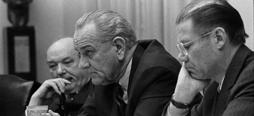 Secretary of State Dean Rusk, President Lyndon Johnson and Secretary of Defense Robert McNamara.