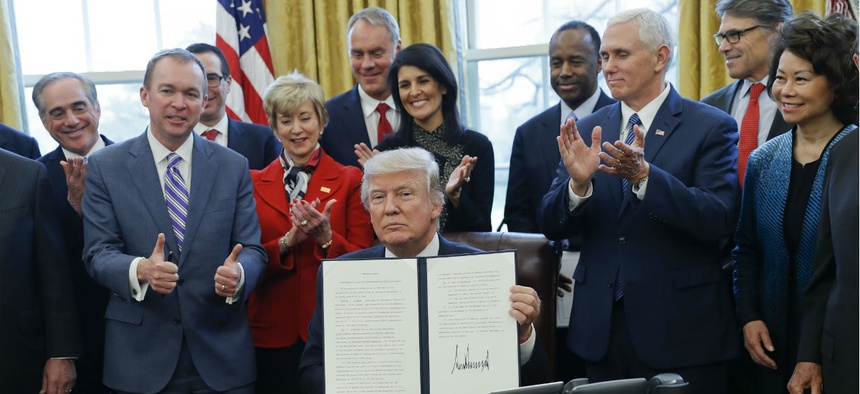 President Trump signs an executive order on reorganizing government.