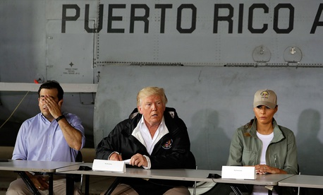 Puerto Rico Gov. Ricardo Rosselló, President Donald Trump and First Lady Melania Trump speak at Luis Muniz Air National Guard Base Tuesday.