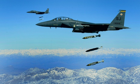 U.S. Air Force F-15E Strike Eagles, from the 335th Expeditionary Fighter Squadron, drop 2,000 pound Joint Direct Attack Munitions on a cave in eastern Afghanistan in 2009.