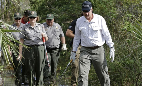 Interior Secretary Ryan Zinke gets a tour from National Park Service employees at Big Cypress National Preserve in Florida, during a three-day trip to assess hurricane damage.